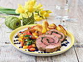 Stuffed leg of lamb with rosemary potatoes and Provençal vegetables