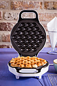Crispy baked bubble waffles in a waffle iron