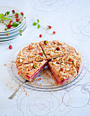 A strawberry cake with nut crumbles