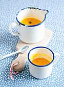 Pumpkin soup in an enamel cup
