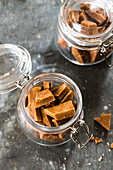 Caramel sweets with fleur de sel in jars