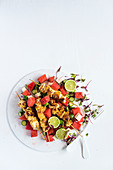 Marinated chicken kebabs on watermelon salad