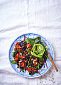 A superfood salad with avocado, cherry tomatoes and baby spinach