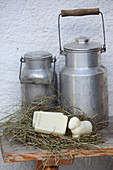 Milk churns and various types of soap made from sheep's milk