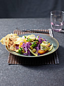 Autumnal red cabbage and endive salad with oranges and lupin beans