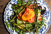 Tomato salad with asparagus and olives