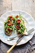 Avocado on rye toast with wild rocket
