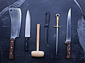 Various knives, meat tenderizers and a sharpening stick
