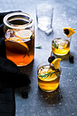Iced tea with oranges, blackberries and rosemary