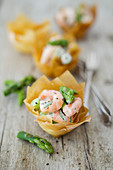 Shrimp cocktail with green asparagus in a filo pastry bowl