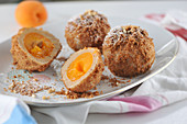 Apricot dumplings wrapped in crunchy hazelnut crumbs (vegan)