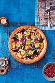 The ultimate Vegetarian Christmas Pie with courgette ribbons, butternut squash, beetroot and leeks, topped with feta cheese and pomegranate seeds