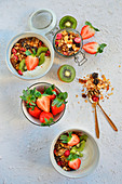 Muesli with yoghurt, strawberries and kiwi
