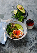 Quinoa salad with spinach, avocado, salmon and caviar