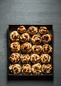 Cardamom Buns in metal tray on grey background