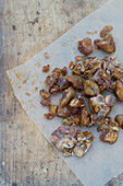 Caramelized almond flakes on paper