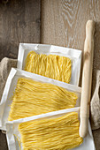 Maccheroncini di Campofilone (thin egg spaghetti) drying on paper