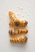 Small pastry horns with chocolate cream and hazelnuts