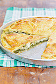 Spanakopita (Greek spinach tart), sliced