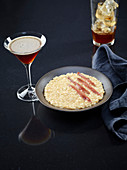Beef marrow risotto with anchovies served with a Tonka cocktail
