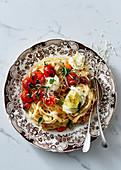 Creamy tagliatelle with tomatoes and buffalo mozzarella