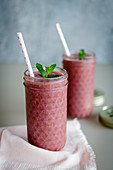 Raspberry and coconut smoothies with wheatgrass