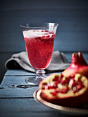 Cocktail made with pomegranate and sparkling wine