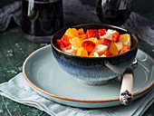 Fruit macedonia salad with strawberries, oranges and banana with lemon juice, brown sugar and orange liqueur