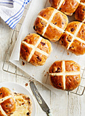 Hot Cross Buns cooling on a rack sitting