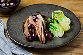 Duck with sour cherry port wine sauce and bok choy