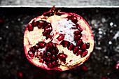Half pomegranate on metal plate