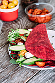 Beetroot wrap with semi-dried tomatoes, greek feta, cucumbers, cherry tomatoes and salad