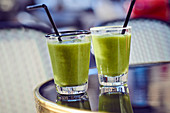 Green smoothies with kiwi, apple and cucumber