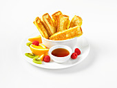 French Toast Stick with berries and marple syrup