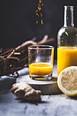Detox and ginger shots with ginger juice, orange juice, lemon juice, turmeric and chilli