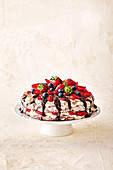 Triple choc low-fat pavlova with berries