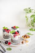 Chia pudding with yoghurt, berries, honey and verbena mint