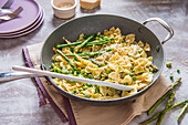 Spring pasta with cream sauce, peas, beans, asparagus and parmesan cheese