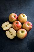 Apples on a dark slate