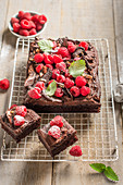 Chocolate tray bake with chocolate butercream icing and raspberries