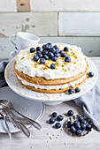Passion fruit and blueberry cake with cream