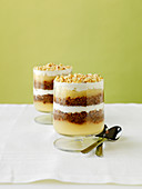 Veiled Country Lass (Layered bread pudding desserts with applesauce and cream, Denmark)