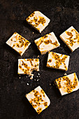Passionfruit swirl cheesecake slice