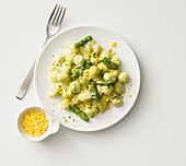 Asparagus and ricotta gnocchi with asparagus tips and egg yolk crumble