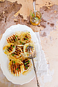 Grilled fennel salad with olives anchovies orange juice and oregano
