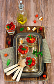 Salt cheesecake with cream cheese, aromatic herbs, cherry tomatoes and raspberries