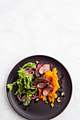 Sumac-crusted lamb with carrot smash and mint salad