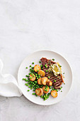 Steak with garlic butter and golden kipflers