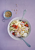 Penne and cauliflower salad with pine nuts