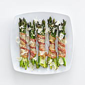 Green asparagus wrapped in bacon with Parmesan
